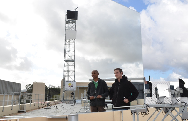 Former STERG researchers and now Alumni, Cebo and Karel, admiring a Helio40 prototype